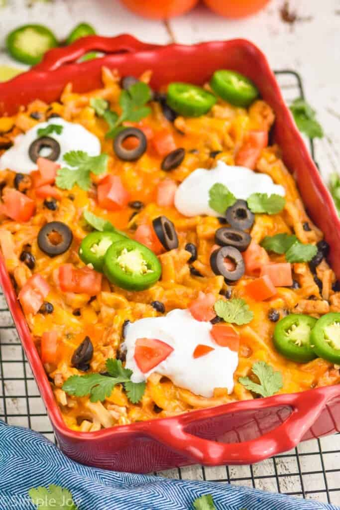 side view of an easy taco casserole in a red baking dish