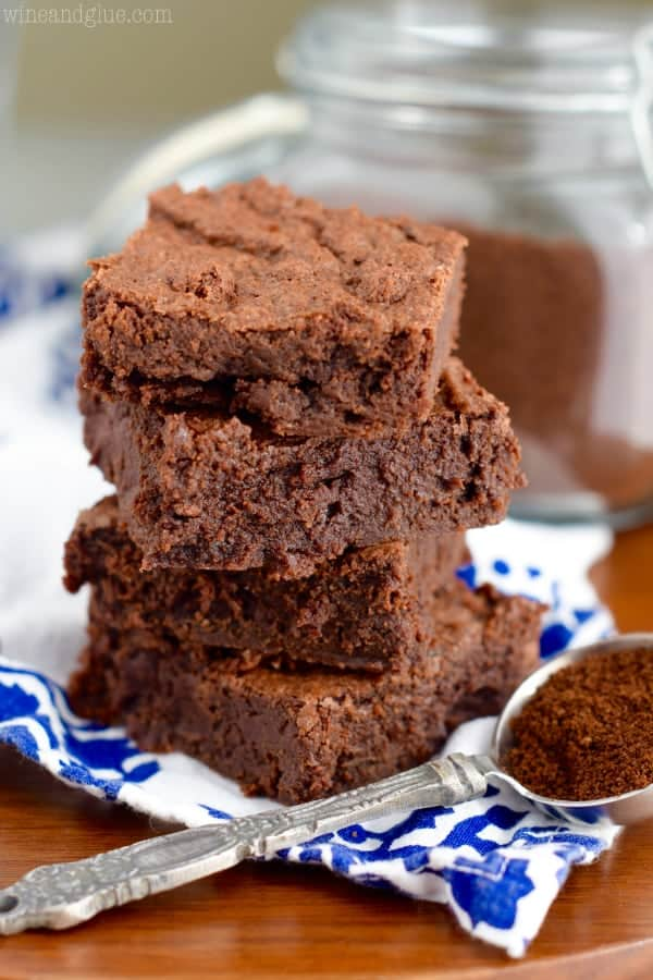 The Mocha Fudge Brownie is stacked showing the moist fudge middle and crisp top.