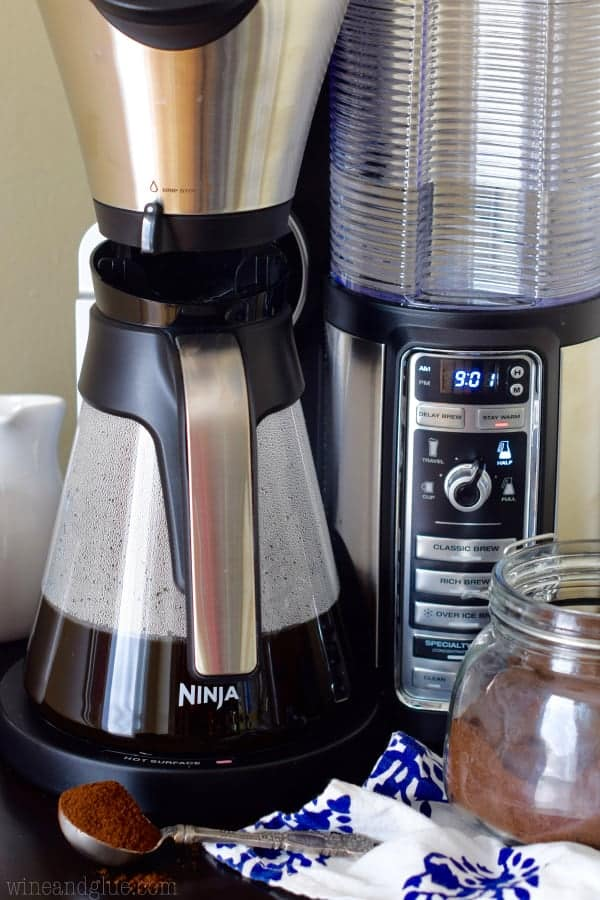 The Ninja Coffee Bar is brewing some coffee into a coffee pot.