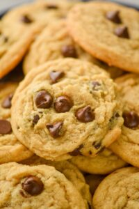 side view of a pile of peanut butter chocolate chip cookies