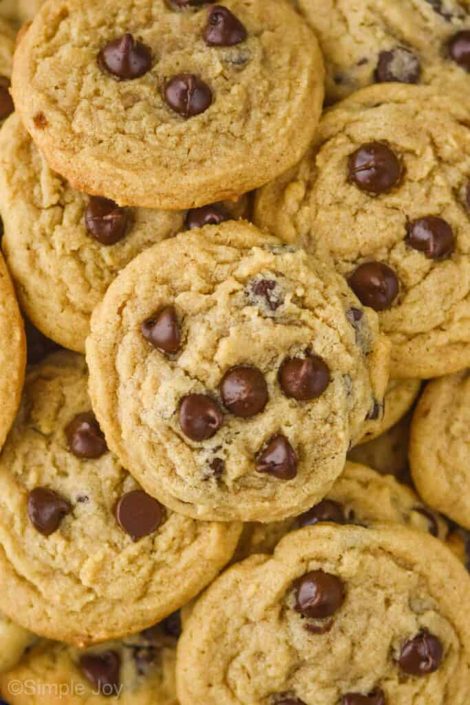 overhead photo of a large pile of peanut butter chocolate chip cookies