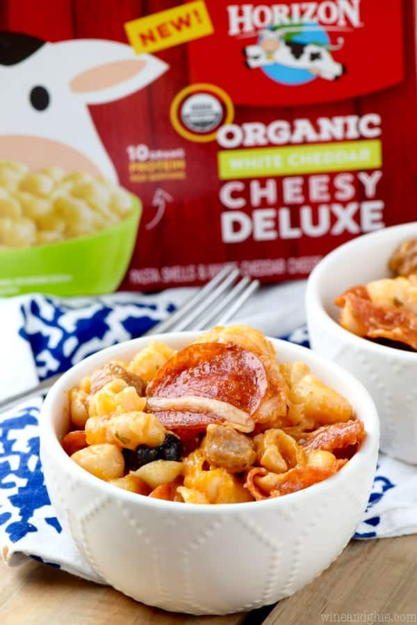 In a small bowl, the Pizza Mac N Cheese in front of the Horizon Organic Cheesy Deluxe Mac and Cheese