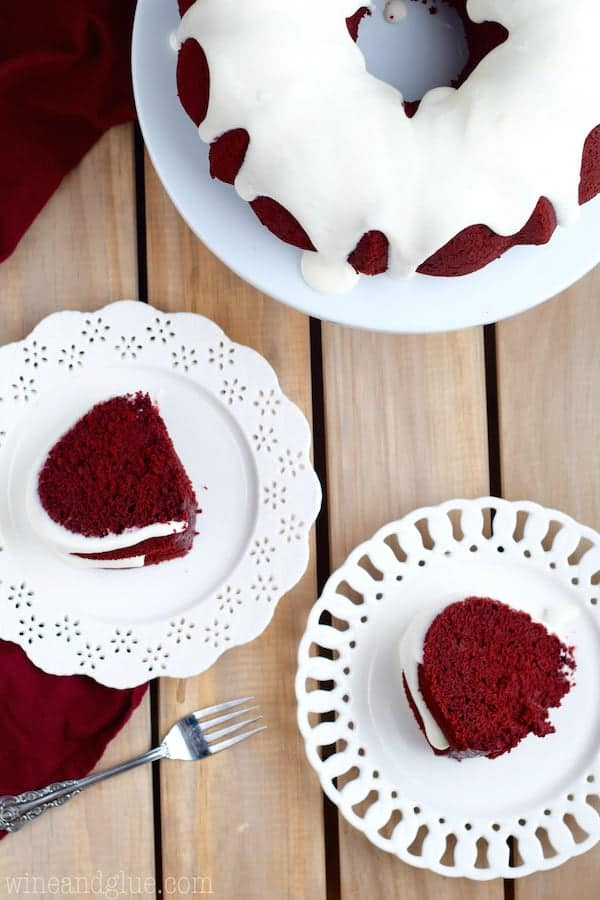 Overhead photos of two plates with a slice of the Red Velvet Bundt Cake with Cream Cheese Buttermilk frosting on each plate.