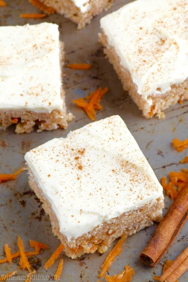 An overhead photo of the Carrot Cake Rice Krispies cut in little squares and topped with cream cheese frosting and cinnamon powder.