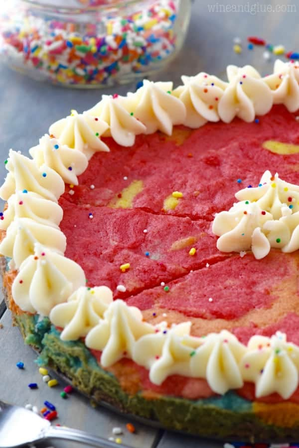 This Rainbow Sugar Cookie Cake is a show stopper! Plus it's totally delicious!