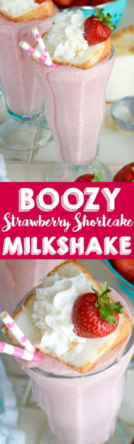 In a milkshake glass, the pink Boozy Strawberry Shortcake Milkshake is topped with a small slice of a strawberry shortcake, a sliced strawberry, and whipped cream.
