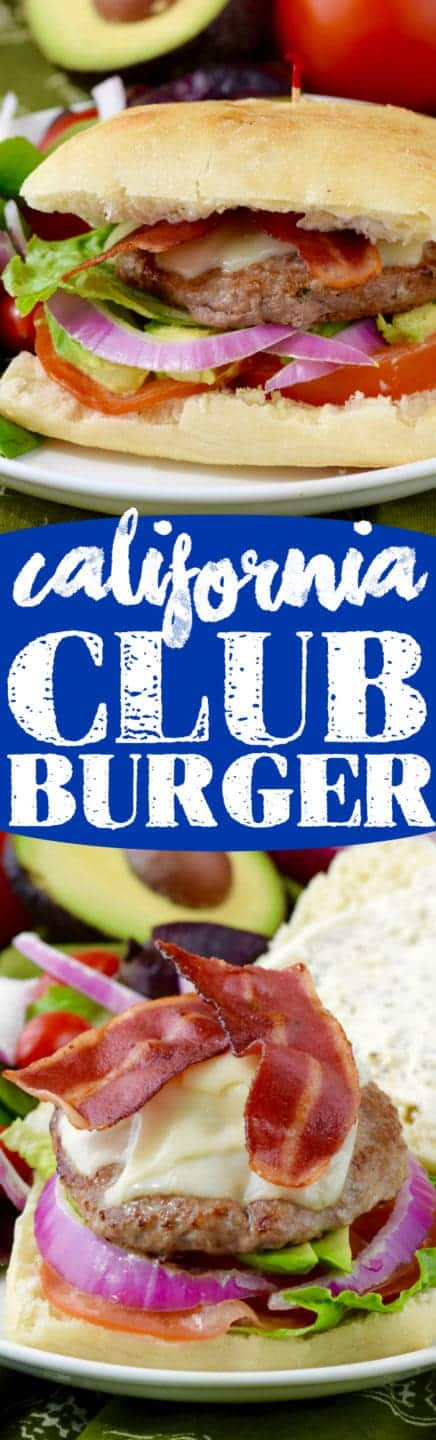 The California Club Burger is in between two ciabatta buns with turkey bacon, turkey burger, lettuce, tomatoes, avocado, and tomatoes with a side of salad.
