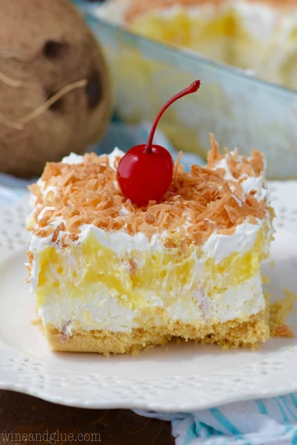 The No Bake Pina Colada Lush has a golden Oreo crust with a fluffy cream and chunks of pineapples for a middle and topped with roasted coconuts.