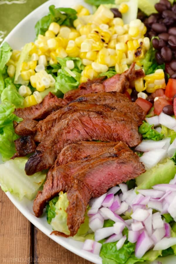 A close up photo of the Southwestern Steak Salad specifically looking at the medium rare steak.