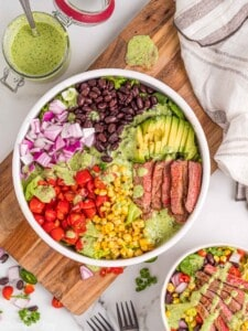 overhead photo of a southwestern steak salad separated by ingredients in a bowl