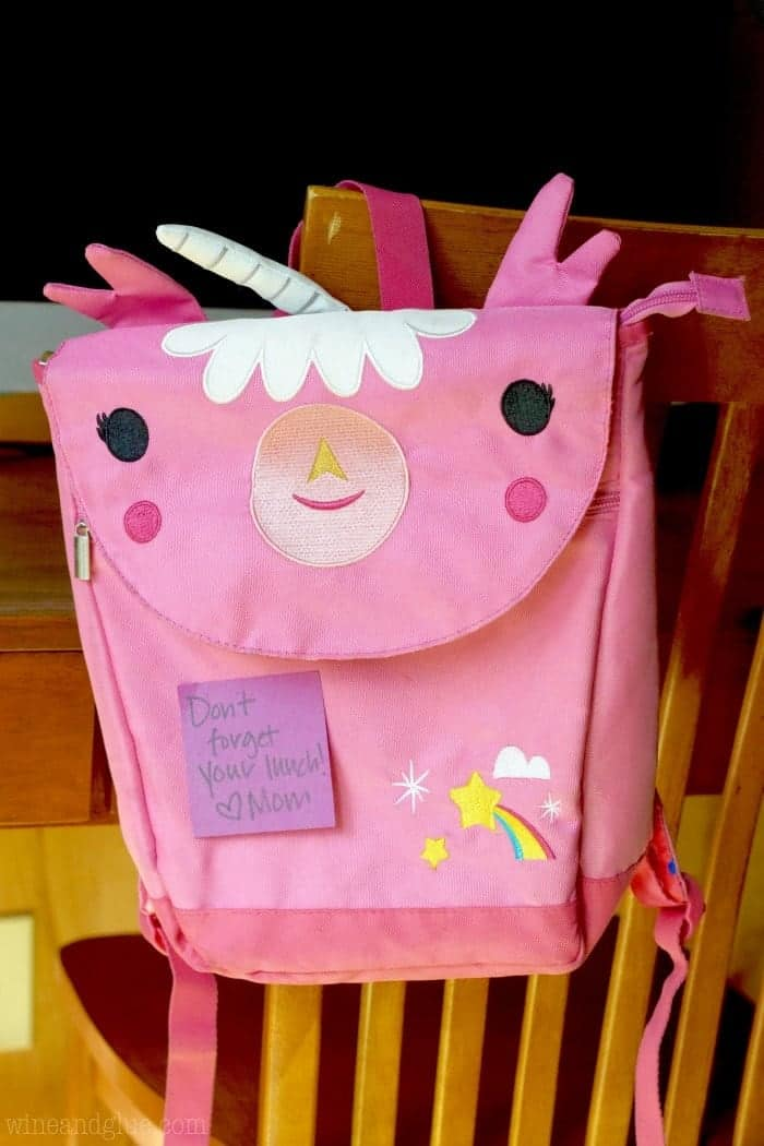 A picture of a unicorn backpack with a note from mom.
