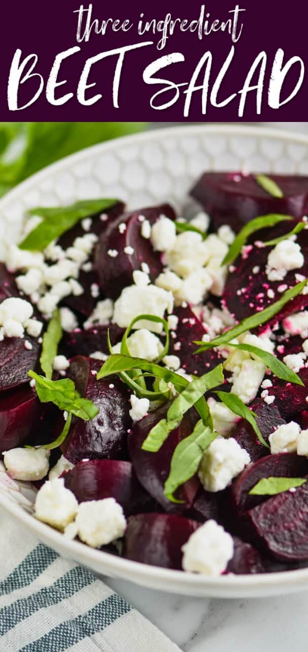 white bowl filled with easy beet salad of roasted beets, feta cheese, and fresh basil