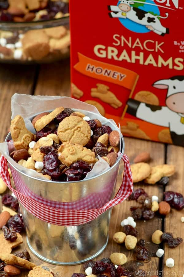 In a little bucket, the S'mores Trail Mix in front the Horizon's Snack Grahams.