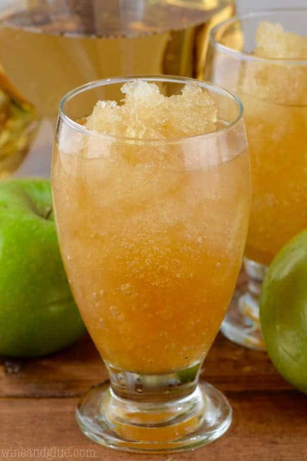 In a glass, the Apple Brandy Slush has a slushy like consistency and has a apple juice coloring.