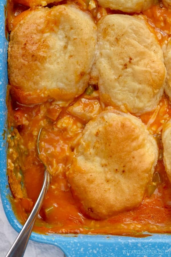 In a casserole dish, the Buffalo Chicken Pot Pie has golden brown biscuits covering the filling.
