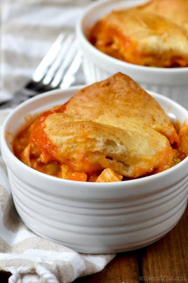 In a white bowl, a scoopful of the Buffalo Chicken Pot Pie fills it up and covered with a golden brown biscuit.