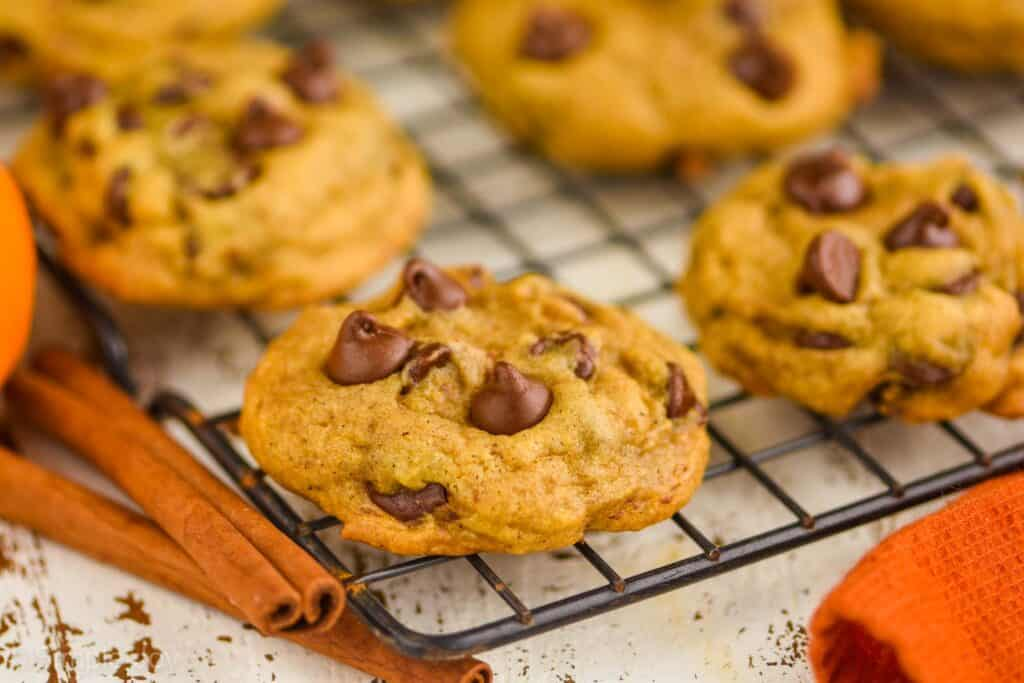several pumpkin chocolate chip cookies on a wire cooling rack