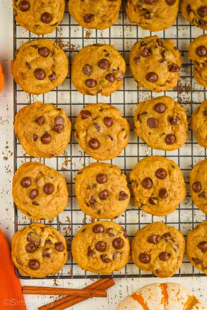 overhead view of pumpkin chocolate chip cookie recipe on a wire cooling rack