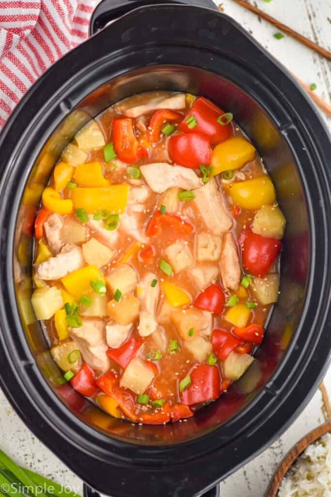 overhead of crockpot sweet and sour chicken in a slow cooker