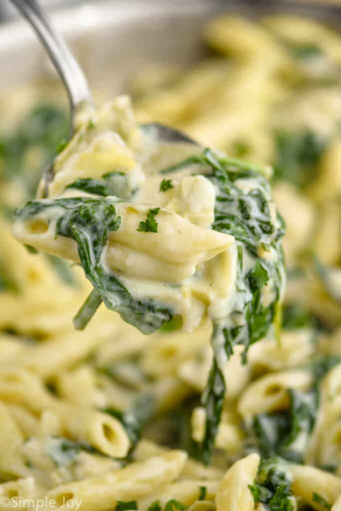 spoonful of spinach artichoke pasta