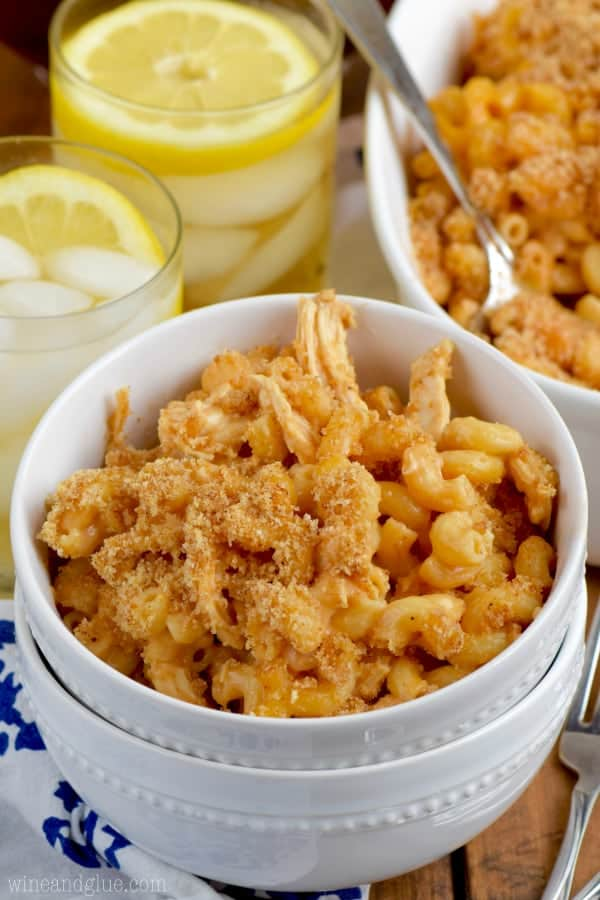 In a white bowl, the BBQ Chicken Macaroni and Cheese has breadcrumbs and chicken mixed in.