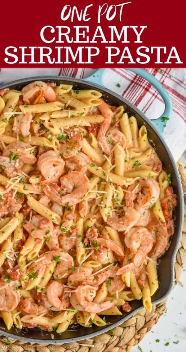 one pot creamy shrimp pasta in a skillet, garnished with parmesan and parsley