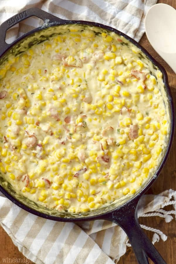 An overhead photo of Bacon Jalapeno Cream Corn which is creamy and colorful for the corn, bacon, and jalapeno.