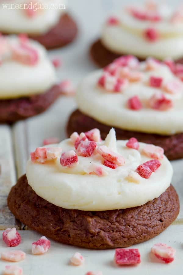 The Chocolate Peppermint Cake Mix Cookies has a dollop of white frosting and topped with broken Peppermints.