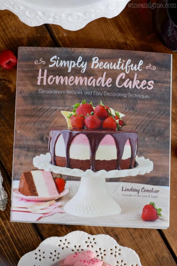 An overhead photo of a magazine that says Simply Beautiful Homemade Cakes by Lindsay Conchar.