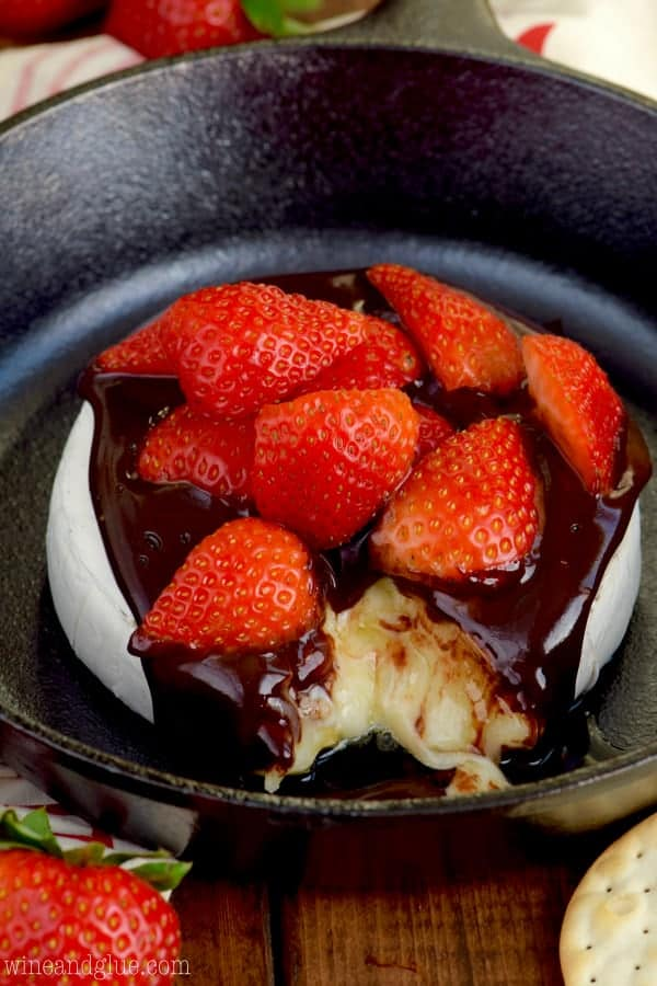This Chocolate Covered Strawberry Baked Brie is a *super* easy appetizer that your guests will love!