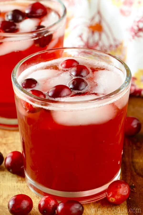 The Cranberry Vodka Press fills a glass with whole cranberries and ice.