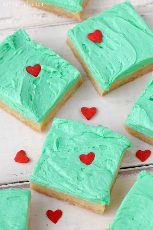 In the shape of little squares, the Grinch Sugar Cookie Bars have the same color green as the Grinch frosting and a heart sprinkle that is 3 sizes too small.