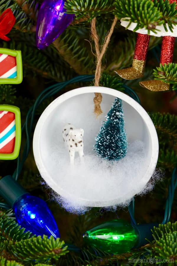 These Winter Wonderland Shadow Box Ornaments are so easy to make! A perfect addition to your tree or to gift!