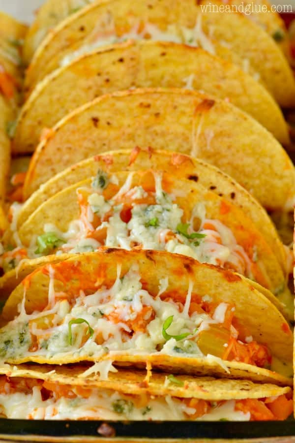 The Buffalo Baked Tacos are in hard taco shells and inside are buffalo chicken and melted cheese.
