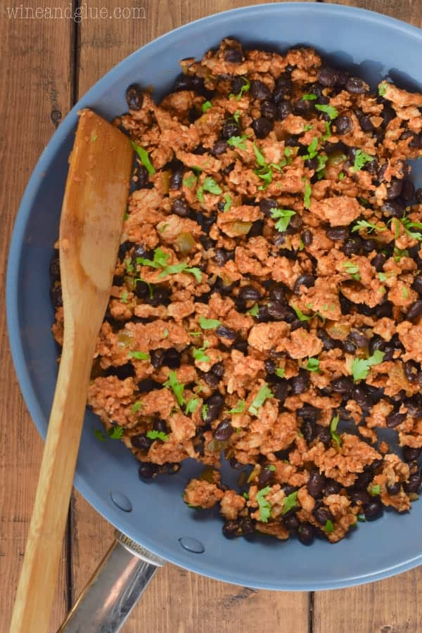 In a sauce pan, the filling for the Southwestern Lettuce Wraps is mixed together – Turkey meat and beans.