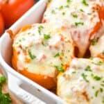 close up of a orange Italian stuffed pepper in a casserole dish