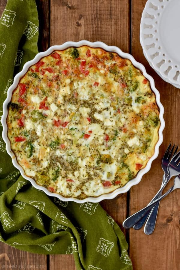 An overhead photo of the Crustless Vegetable Quiche in a ceramic pie pan