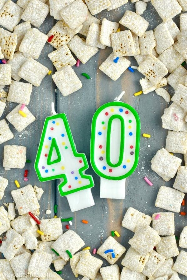 An overhead photo of birthday candles with the numbers 40 surrounded by the Funfetti Cake Batter Muddy Buddies.