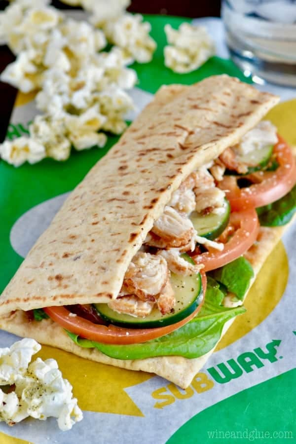 Subway's Rotisserie-Style Chicken sandwich surrounded by the Italian Popcorn.