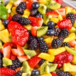 pinterest graphic of fruit salad recipe in a white bowl