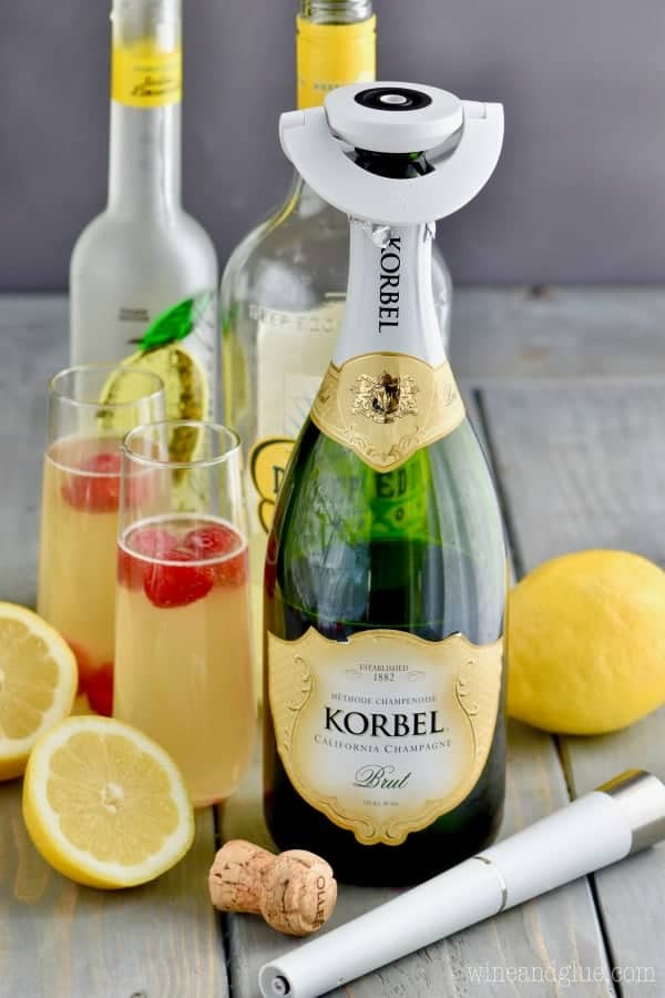 The ingredients of the Lemon Champagne Cocktail is shown (limocello, lemon vodka, and champagne.)