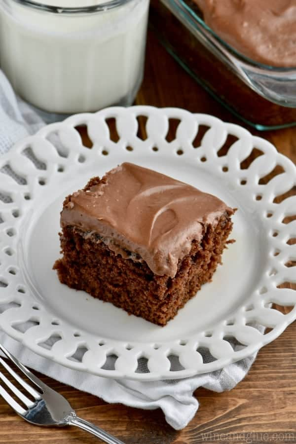 On a decorative white plate, the Chocolate Snack Cake has a moist cake layer and a shiny chocolate frosting.
