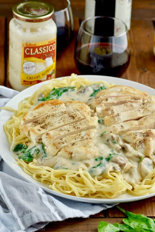 Long strips of chicken and creamy white sauce top the Easy Chicken Fettuccine Alfredo