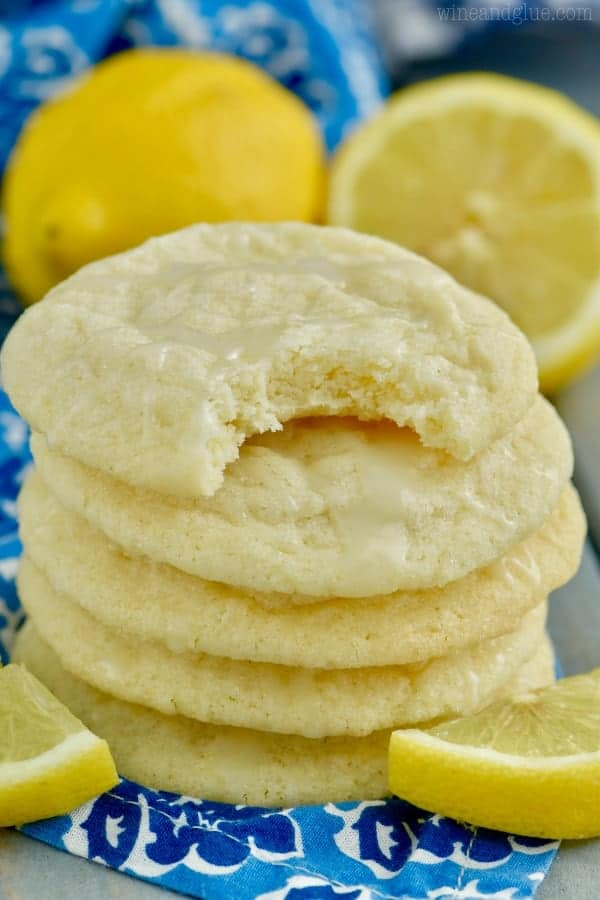 A stack of Lemon Sugar Cookies are shown, and the most top cookie has a small bite into.