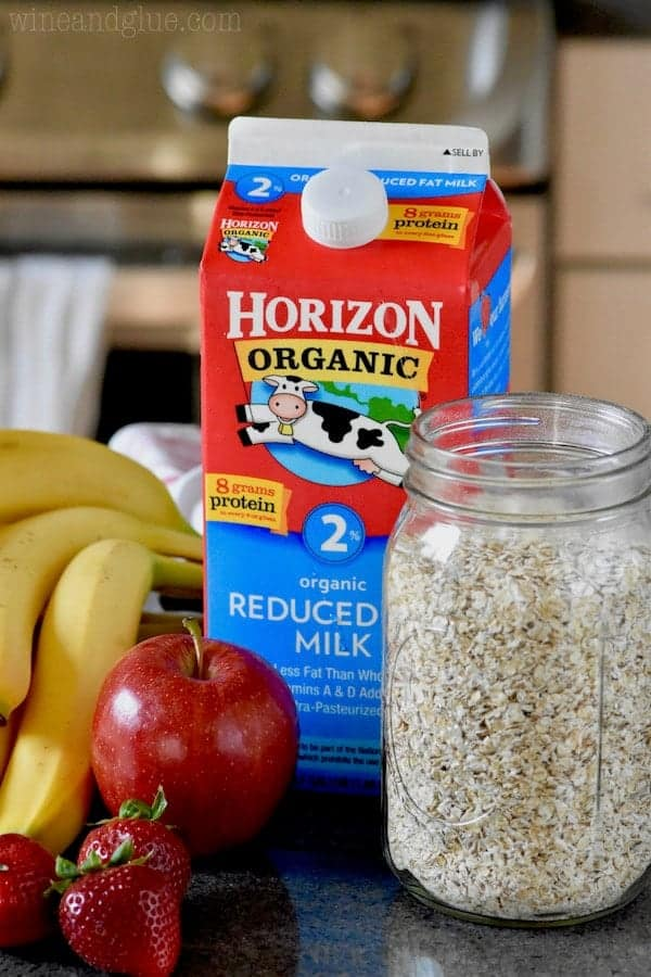 The ingredients for some overnight oats are shown (banana, apple, strawberries, oats, and Horizon's 2% Milk)