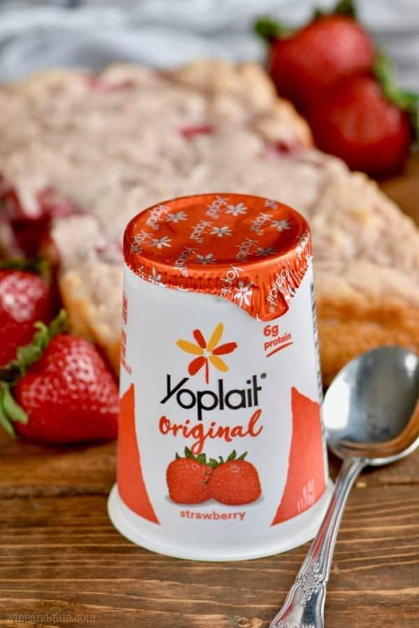 Yoplait's original strawberry yogurt is in front of the Three Ingredient Yogurt Bread