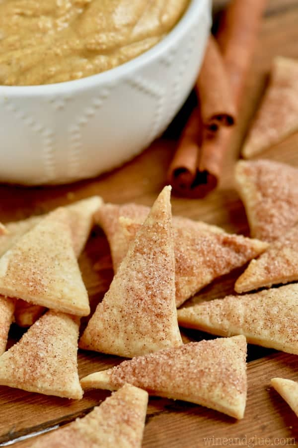 Close up photo of the Cinnamon Sugar Pie Crust Dippers that are in little triangles and coated with cinnamon and sugar.