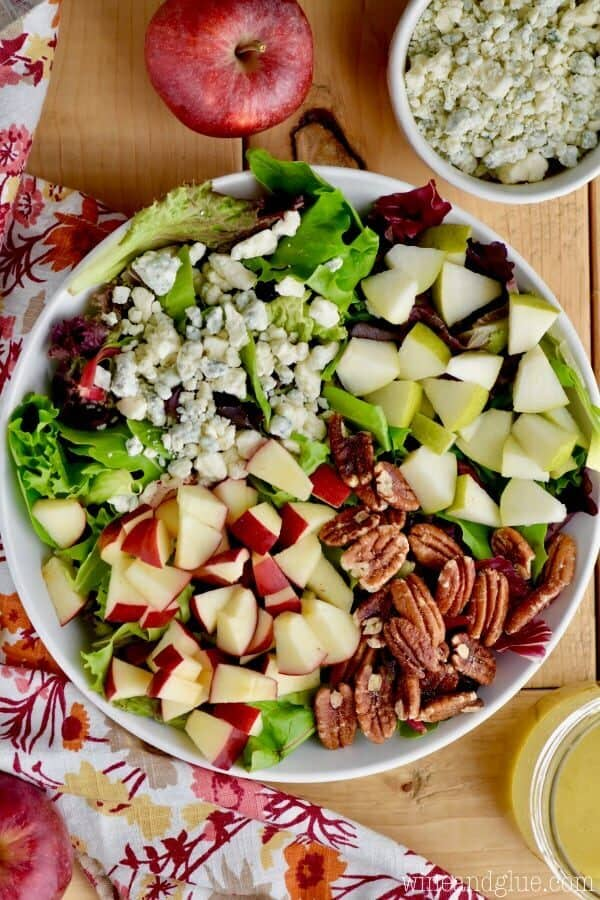 overhead view of fall salad with cut up apples, pears, blue cheese, and pecans