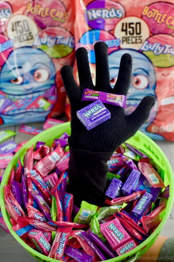 The Scary Halloween Treat Bucket has a hand coming out and filled with candy