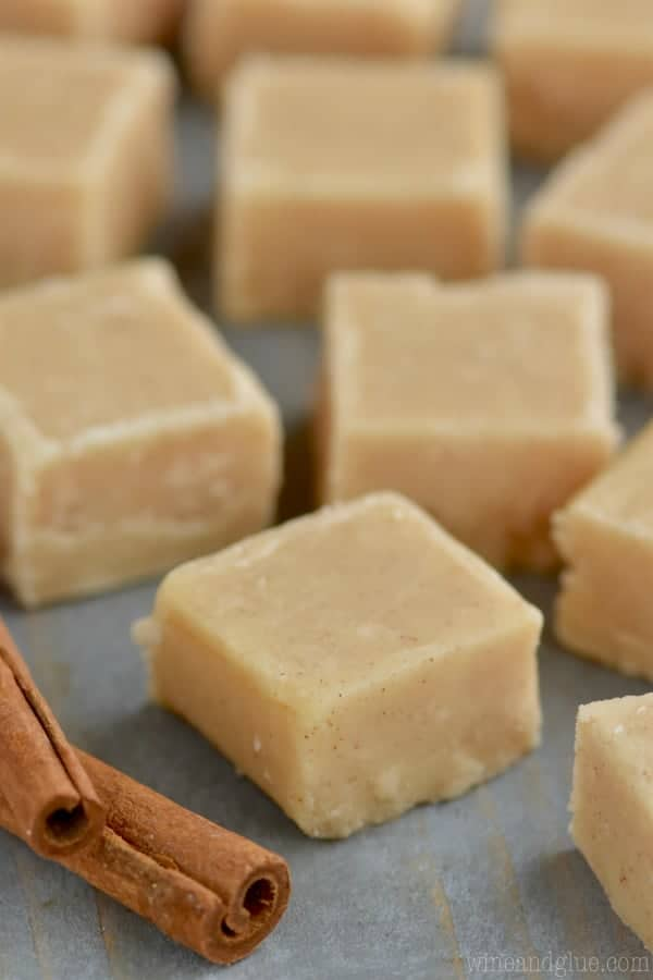 In little cubed shapes, the Eggnog Fudge is sprinkled around a blue counter.